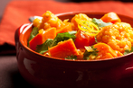 Winter vegetable curry with carrots, peas and tomatoes