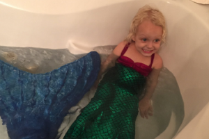 Babysitter makes this little girls dreams come true with matching mermaid costumes