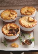 Beef and stout pies with potato pastry topping