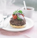 Inverted cashel blue burger with roasted tomatoes and red onion salad
