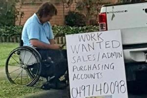 Disabled man holds up sign asking for a job- what happens next will warm your heart