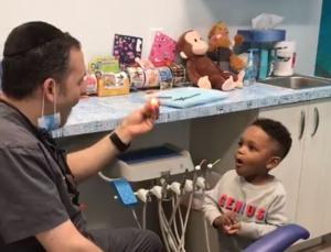 Kid mesmerised by dentist who performs incredible magic trick to keep him calm