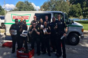 Cops give away goodies to the homeless from stolen Krispy Kreme van