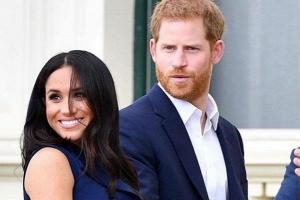 Meghan Markle shows off her petite baby bump as royal tour continues